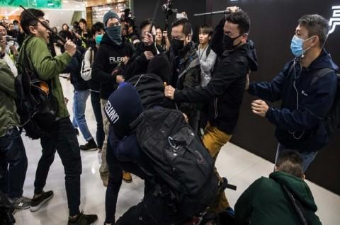Pedemo Desak Pedagang Tiongkok Tinggalkan Hong Kong