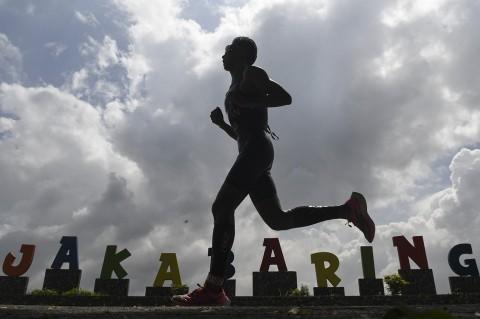 Jauhari Johan Juara Palembang Triathlon 2020