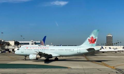 Wabah Pandemi Korona, Air Canada PHK Setengah Pekerjanya