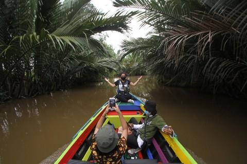 Menikmati Wisata Susur Sungai di Banjarmasin