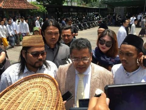 Komentar Hotman Paris soal Putusan KPPU kepada Grab Indonesia