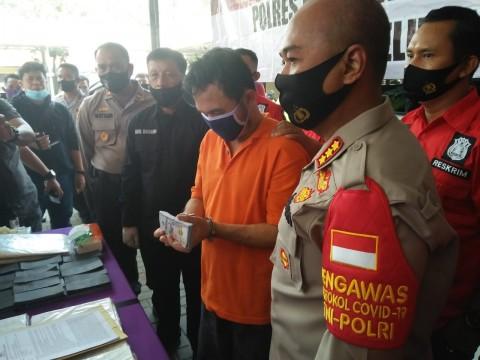 Polisi Ringkus Pembuat Dolar Palsu Senilai Rp9,8 Miliar