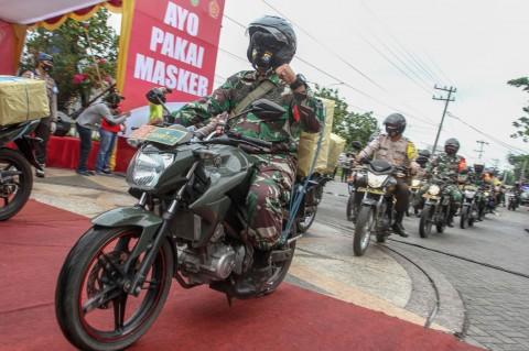 Polda Riau Bagikan 630 Ribu Masker untuk Warga