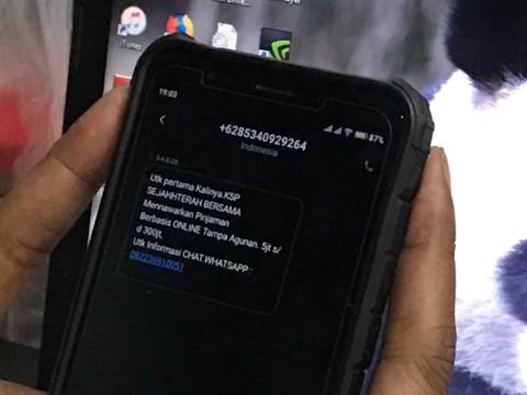 <i>Fintech</i> Tawarkan Pinjaman <i>Online</i> via SMS, Siap-siap Dicabut Izinnya