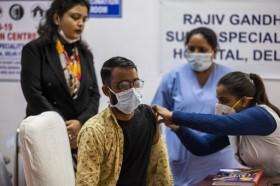 Populer Internasional: Nakes India Meninggal Usai Divaksin Hingga AS-Tiongkok Bentrok di WHO