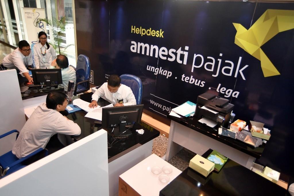 Ilustrasi pusat pelaporan amnesti pajak - - Foto: Antara/ Yudhi Mahatma