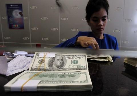 Dolar AS Lesu di Tengah Rilis Data Ekonomi