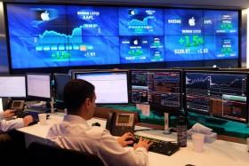 Dow Jones Meroket 238 Poin, Sektor Jasa Komunikasi Jadi Penyelamat