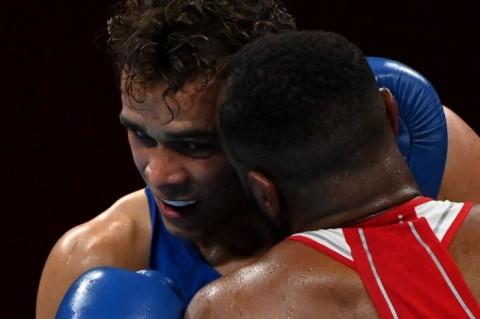 Aksi Gigit Kuping ala Mike Tyson Terjadi di Olimpiade Tokyo, Petinju Ini Didiskualifikasi