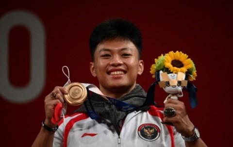 Profil Rahmat Erwin Abdullah, Lifter Masa Depan Indonesia yang Bersinar di Olimpiade 2020