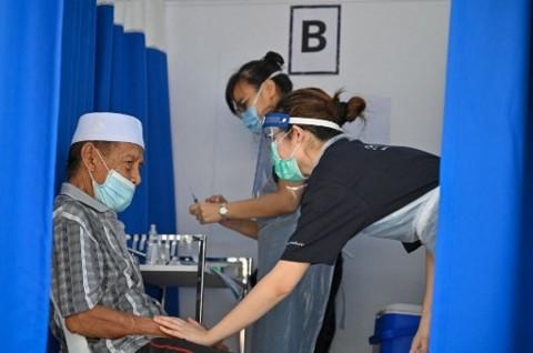 Laju Vaksinasi di 3 Wilayah Malaysia Dekati Angka 100 Persen