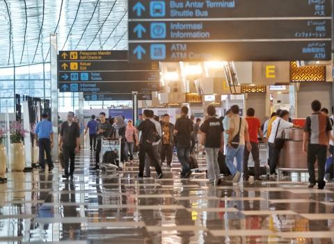 Tiba dari Luar Negeri, <i>Traveler</i> Wajib Tes PCR di Bandara Soetta
