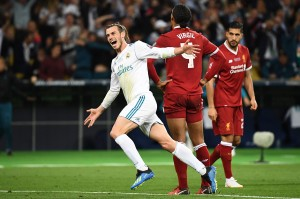 Gol Gareth Bale di menit ke-64 lantas membawa Madrid kembali memimpin. Tendangan saltonya menyambut umpan lambung Marcelo melesak ke pojok kiri atas gawang Liverpool. AFP/FRANCK FIFE