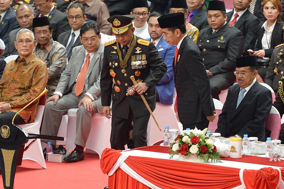 Presiden Joko Widodo yang bertindak sebagai inspektur upacara meminta personel Polri terus meningkatkan kinerja dan membuang budaya koruptif serta mengedepankan pencegahan dan tindakan humanis dalam menangani persoalan sosial. Antara Foto/Wahyu Putro A