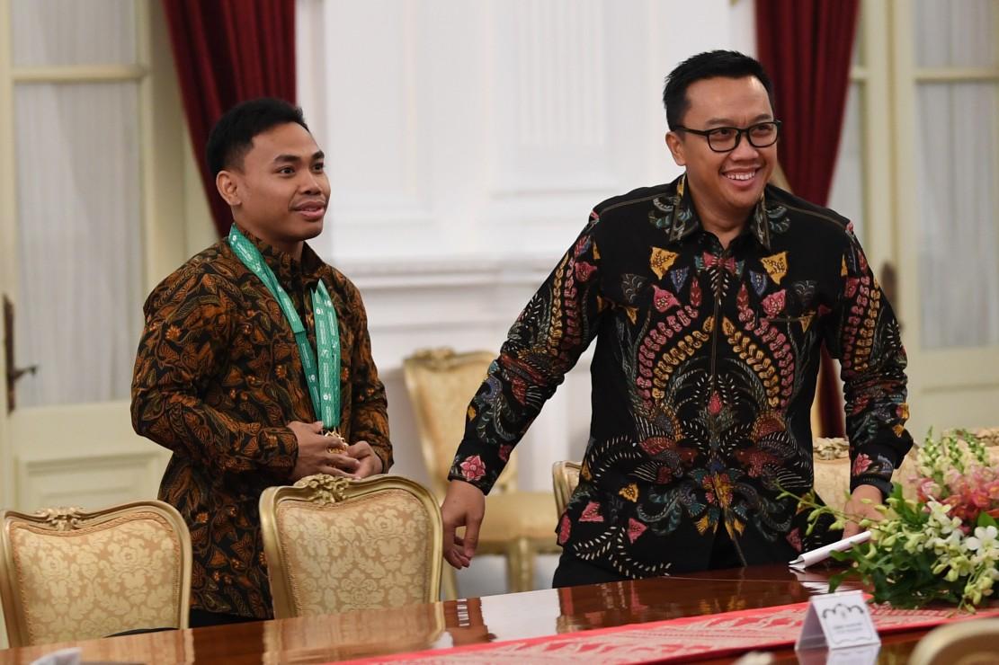 Terima Eko Yuli, Jokowi: Pemerintah dan Rakyat Indonesia Bangga