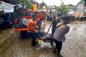 Sebanyak 745 orang terluka dan 30 orang lainnya hilang. Korban meninggal paling banyak di Pandeglang. Afp Photo/Ronald