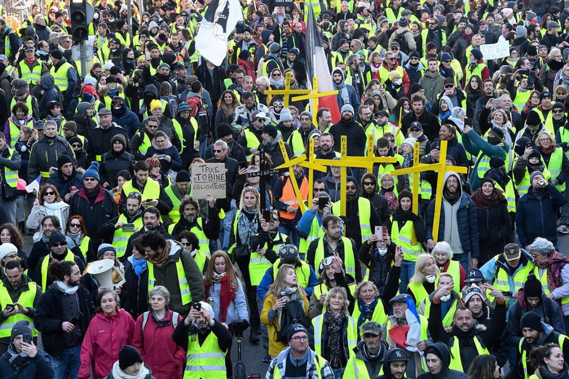 Aksi ini tak hanya berlangsung di Kota Paris saja. Beberapa kota di sekitar Paris juga terdapat aksi serupa. Afp Photo/Mehdi Fedouach