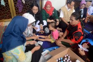 IDI Kota Makassar bersama Persatuan Rumah Sakit Indonesia Makassar bekerja sama memberi pelayan pengobatan gratis kepada korban terdampak banjir di sejumlah wilayah di Makassar.