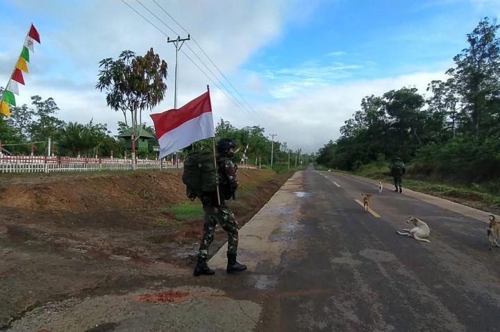 Prajurit Satgas Yonif 125/Simbisa Gelar Patroli Patok Batas