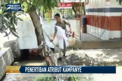 Panwaslu dan Satpol PP Bersihkan Atribut Kampanye