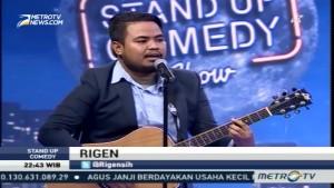 Rigen Bawakan Berita dengan Gitar