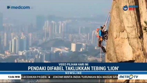Pendaki Difabel Taklukan <i>Lion Rock</i> dengan Kursi Roda