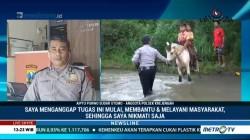 Aiptu Purwo Bantu Anak Dusun Seberangi Sungai Menuju Sekolah