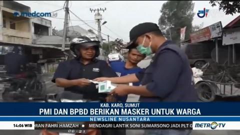 Pascaerupsi Sinabung, PMI dan BPBD Karo Bagikan Masker Gratis