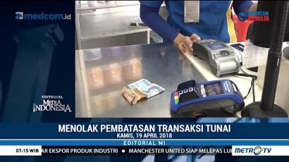 Menolak Pembatasan Transaksi Tunai