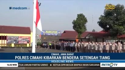 Polres Cimahi Kibarkan Bendera Setengah Tiang
