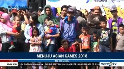 Warga Malang Antusias Melihat Api Obor Asian Games 2018