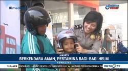 Berkendara Aman, Pertamina Bagi-bagi Helm untuk Anak