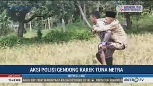Aksi Polisi Gendong Kakek Tunanetra Viral