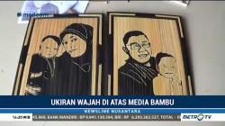 Ukiran Wajah di Media Bambu