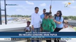 Viral Iriana Jokowi Gendong Anak Papua