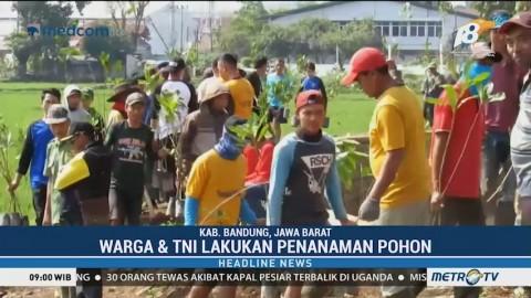 Warga dan TNI Lakukan Penanaman Pohon di Sungai Cisaraya Majalaya