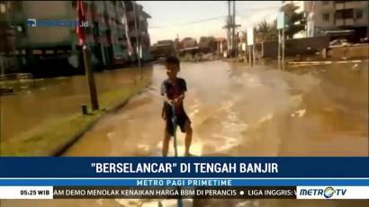 Berselancar di Tengah Banjir