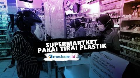 Cegah Covid-19, Supermartket Pakai Tirai Plastik