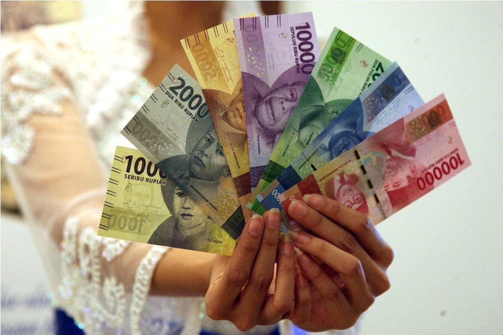 Rupiah Pagi Parkir di Rp14.026/USD
