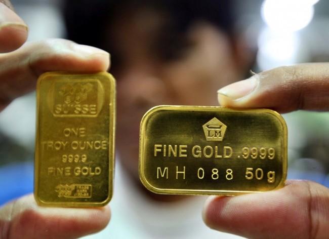 Harga Emas Antam Turun Rp7.000/Gram